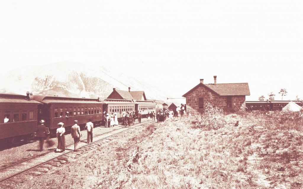 Summer train tourists and depot circa 1882